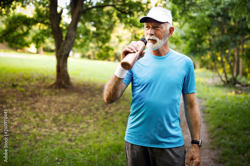 Portrait of athletic mature man after run. Handsome senior man resting after jog at the park © nd3000