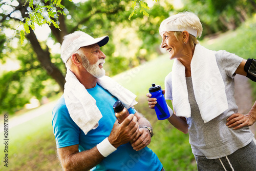 Leinwandbild Motiv Mature couple jogging and running outdoors in city