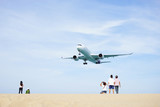 Extreme Landing aircraft above the beautiful Mai khao beach near  Phuket Airport. Watching planes landing with a beautiful beach as a background. Excellent photo playground for tourist.