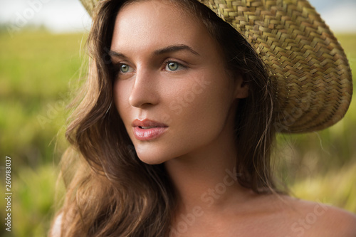 canvas print picture Young lovely woman wearing straw hat