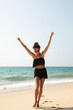 Quadro Stylish and beautiful woman on the beach