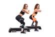 Two slim women in sportswear doing fitness view