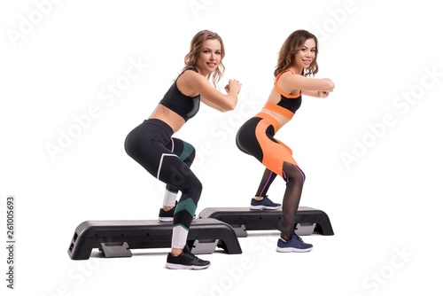 canvas print picture Two slim women in sportswear doing fitness view