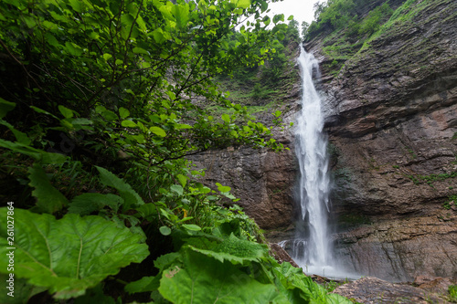 Huge waterfall deep in forest - 261027864