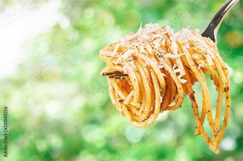 Fork with just spaghetti around it on backgrouund - 261044256