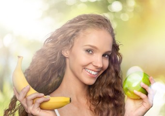Attractive caucasian woman with fruit salad  on background