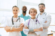 Leinwanddruck Bild - Healthcare people group. Professional male and female doctors posing at hospital office or clinic. Medical technology research institute and doctor staff service concept. Happy smiling models.