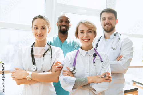 Leinwanddruck Bild Healthcare people group. Professional male and female doctors posing at hospital office or clinic. Medical technology research institute and doctor staff service concept. Happy smiling models.