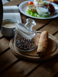 Glass jar and beans of natural coffee.