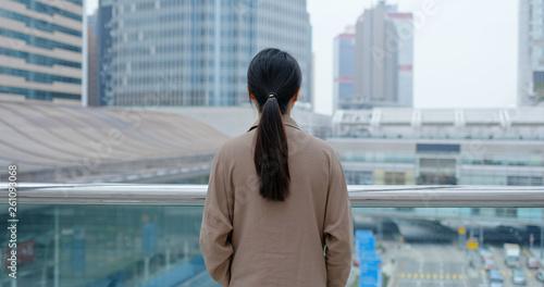 Leinwanddruck Bild Businesswoman look in the city of Hong Kong