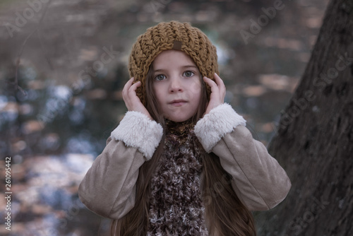 Portrait of a girl in autumn clothes on a background of nature.