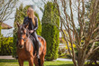 Woman on a horse at rancho. Horse riding, hobby time. Concept of animals and human  - 261097012