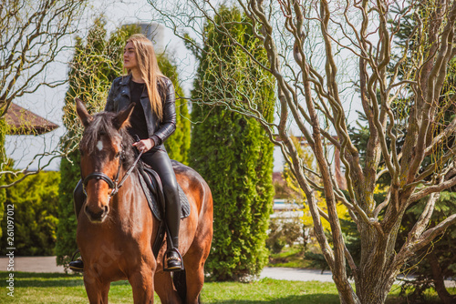 Woman on a horse at rancho. Horse riding, hobby time. Concept of animals and human