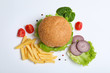Leinwanddruck Bild - Composition with burger and french fries on white background