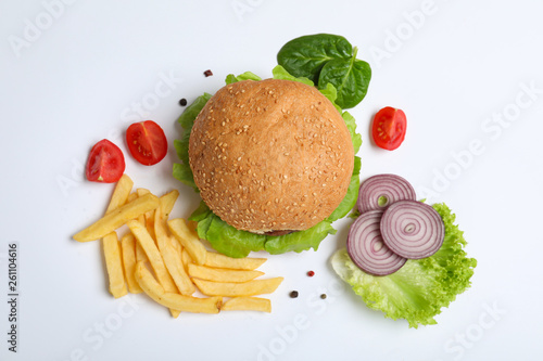 Leinwanddruck Bild Composition with burger and french fries on white background