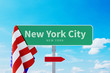 New York City Road or Town Sign. Flag of the united states. Blue Sky. Red arrow shows the direction in the city
