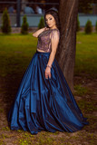 Beautiful young lady in luxury blue dress for her prom night