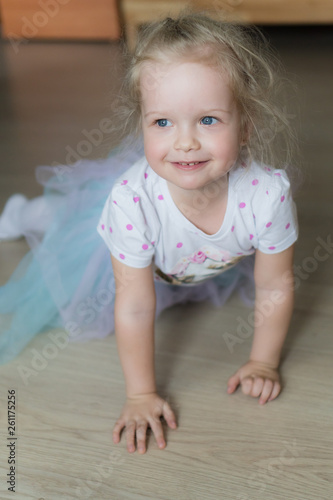 canvas print picture Little girl crawling on the floor and smiling