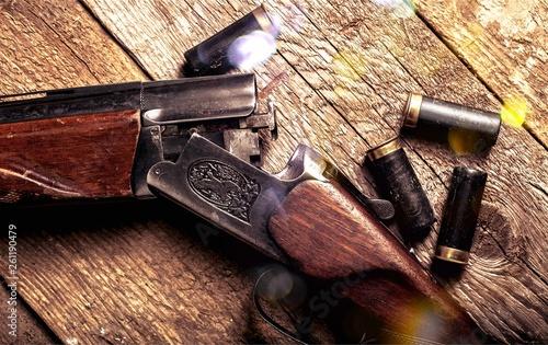 Leinwandbild Motiv Vintage rifle and sleeves on wooden table