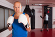canvas print picture - Portrait of boxer wearing gloves at boxing hall