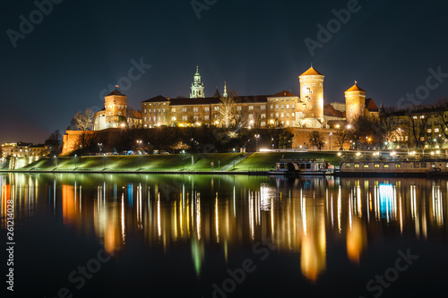 The Royal Wawel Castle as seen from another bank of Vistula. Krakow is the most famous landmark in Poland. Night view