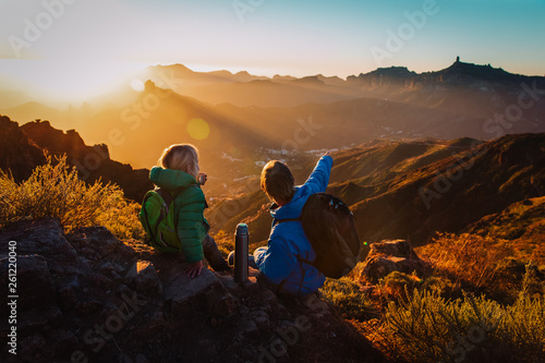 father and daughter travel in mountains, family hiking