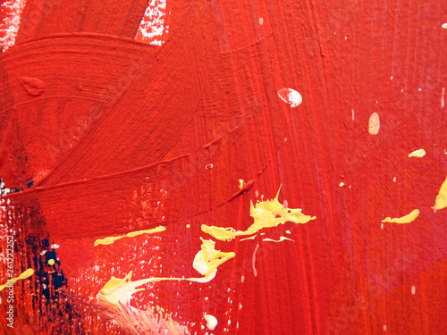 The abstract dabs of paint on the cement wall. - 261222252