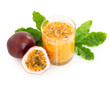 Fresh passion fruit juice in glass with green leaf isolated on white background, fruit healthy concept