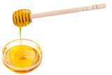 honey in a glass cup. spoon for honey in a cup.  honey flows into a glass cup