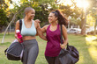 Curvy friends walking home after fitness exercise