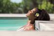 Quadro Beautiful african woman in pool relaxing