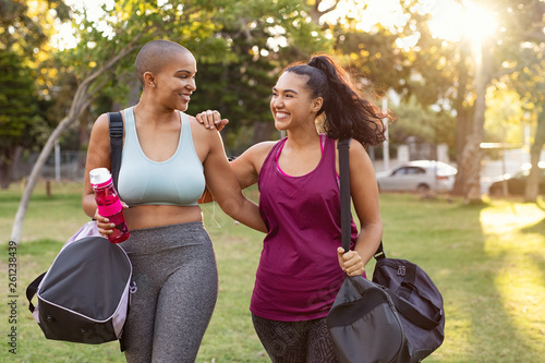 canvas print picture Curvy friends walking home after fitness exercise