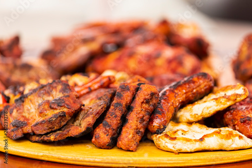 close up of mix grill served on a plate, selective focus
