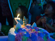 Closeup Of Birthday Cake With Candle And Dessert Decoration On Party In Playroom