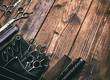 Leinwanddruck Bild - Stylish professional barber scissors on vintage wooden table, hairdresser salon concept, hairdressing tool set. Haircut accessories