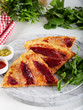 Smoked Ribs pizza with arugula and parmesan cheese on wood table background.  - 261257699