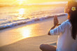 Woman Practicing Lotus Pose on Beach