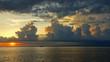 canvas print picture - Sonnenuntergang mit gelb angestrahlten und konturenreichen Wolken über dem Meer