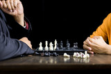 hand of businessman moving chess figure in competition board game for development analysis, strategy idea management or leadership concept.