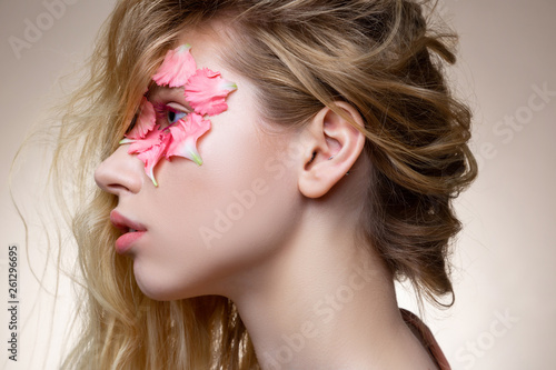 canvas print picture Appealing model having pink mascara and flowers near eye