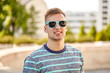 canvas print picture - people concept - portrait of young man in sunglasses outdoors in summer city