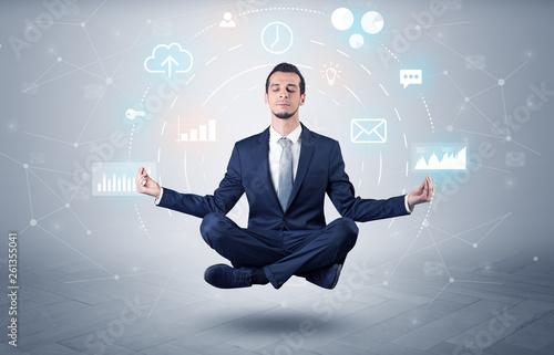 Leinwanddruck Bild Elegant calm businessman levitates in yoga position with data circulation concept