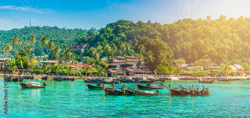 Leinwanddruck Bild Tonsai Beach bay with traditional longtail boats parking in Phi Phi island, Krabi Province, Andaman Sea,  Thailand