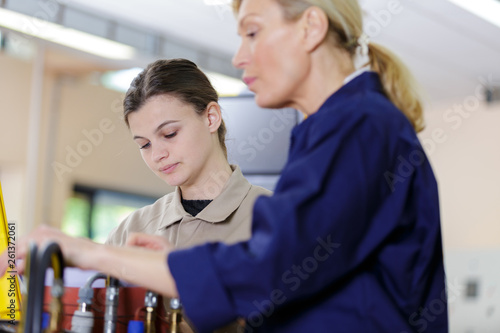 canvas print picture female production workers in the new factory