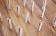 Unique, individuality, leadership and think different concept. One wooden clip difference with other clips on wooden floor