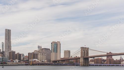 Fototapeten Brooklyn Bridge Brooklyn Bridge over East River with skyline of Manhattan, in New York, USA