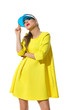 Fashion Model In Yellow Dress And Sun Visor