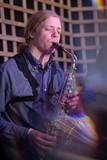 Musician playing alto saxophone