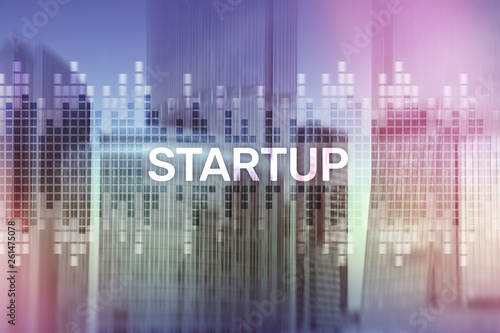 Startup concept with double exposure diagrams blurred background. - 261475078