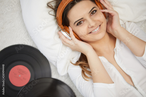 the image of resting sexy woman listening to vinyl - 261494448